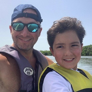 Dr. Guzman and son at the lake